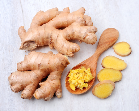 grated: Ginger root. Slices ginger. Grated ginger on white background. Stock Photo