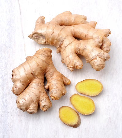 Ginger root. Slices ginger on white background. Banco de Imagens