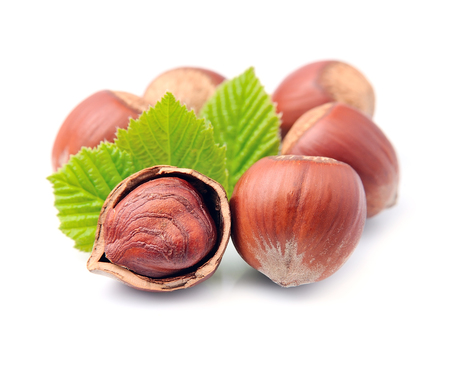 filbert: Filbert nuts with leaf on white background . Hazelnuts. Stock Photo