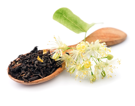 linden flowers: Tea with linden flowers close up Stock Photo