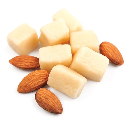 marzipan: Marzipan with almonds on white background