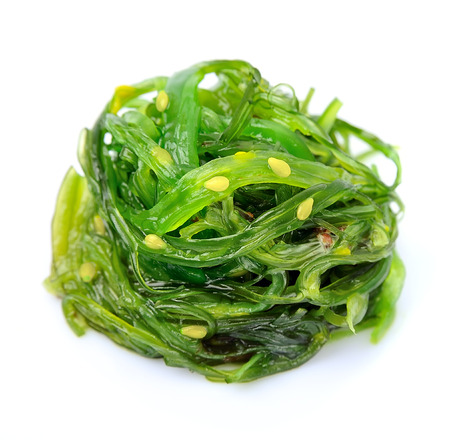 algae: Fresh seaweed salad isolated on white. Japanese cuisine.