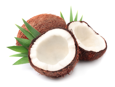 copra: Coconuts with leaves on a white background