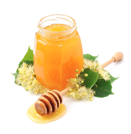 linden flowers: Honey with linden flowers on white closeup Stock Photo