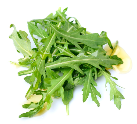 Arugula leaves salad with oil isolated on white