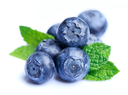 ripe: Sweet blueberries with mint leaves close up . Stock Photo