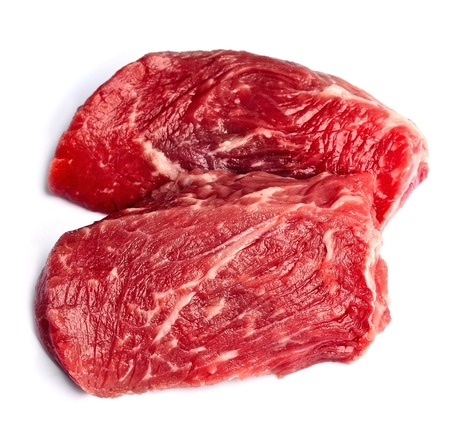 meaty: Piece of crude meat isolated on white backgrounds. Stock Photo