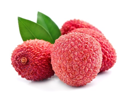 Sweet lychees fruits with leaves close up on white background .