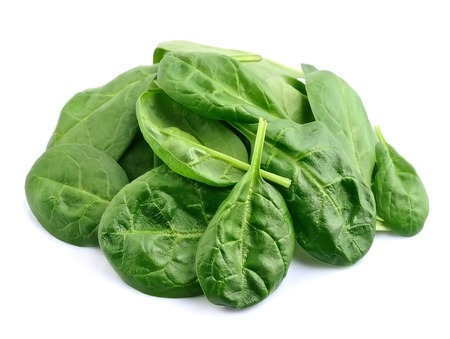 heap up: Spinach leaves close up isolated on white. Stock Photo