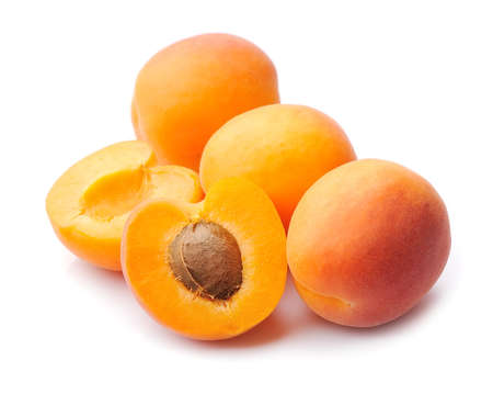 Sweet apricots isolated on white backgrounds closeup.