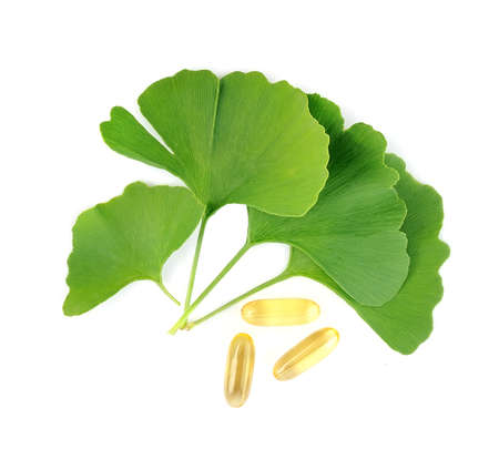 Ginkgo biloba with vitamin pille isolated on white backgrounds. Stock Photo