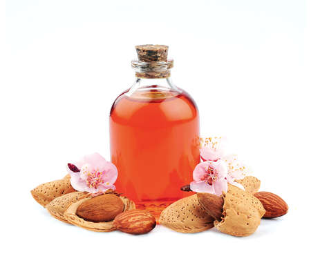 Almonds oil with almonds flower on white backgrounds.