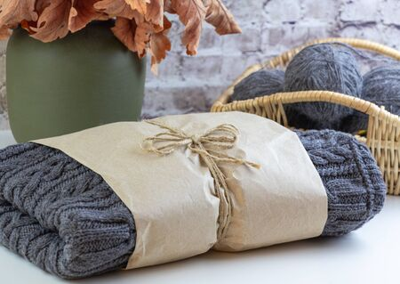 Handmade sweater wrapped in kraft paper.