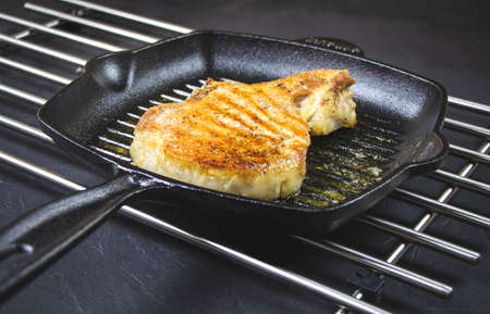 Pork fillet chops in a pan. Grilled meat. High quality photo