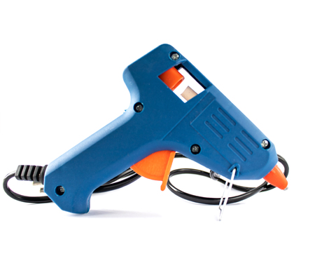 Glue gun blue on a white background. Stockfoto