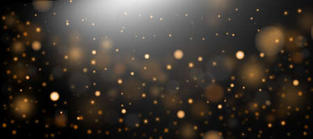 Golden abstract bokeh background. Defocused abstract flickering lights on a black background. Golden bokeh.