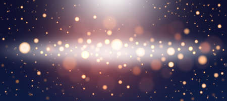 Golden abstract bokeh background. Defocused abstract twinkling lights on a blue background. Golden bokeh.