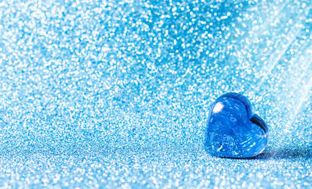 Glass blue hearts on a blue background. Concepts of valentines day card, wedding and invitation. Place for your text.