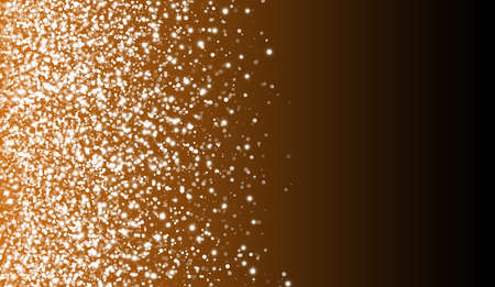 Gold glitter particles on a dark background. Explosion of yellow confetti. Suitable for wedding invitations, posters, Christmas and greeting cards. Background effect