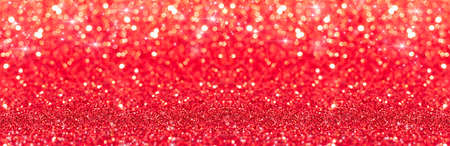 Shiny red background with sparkling stars. Glitter holiday beautiful background. Abstract red background.