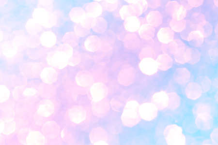 Shiny blurred purple background with bokeh for a festive mood. Greeting card template for fun. Blurry bokeh