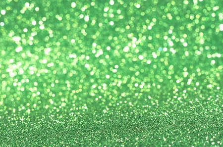 Shiny blurred green background with bokeh for a festive mood. Greeting card template for fun. Blurry bokeh Banque d'images