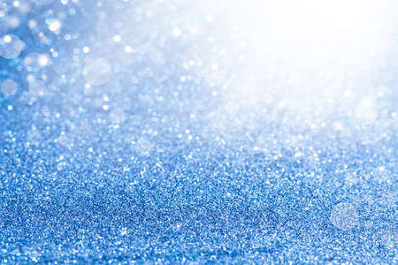 Shiny blurred blue background with bokeh for a festive mood. Greeting card template for fun. Blurry bokeh Banque d'images