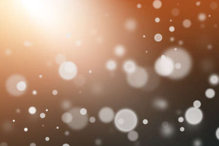 Festive abstract texture with bokeh on a dark background, white bokeh particles fly towards the spotlight.