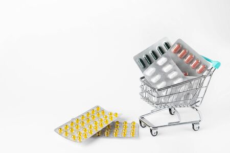 Shopping cart with many pills and drugs. free space for text