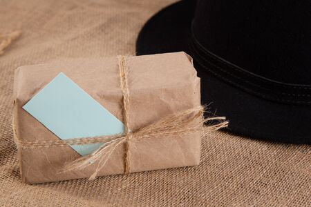 Gift box on the table.Nearby hat.Fathers Day congratulation concept
