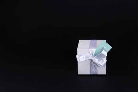 Gift box with bow and card. . Space for text.