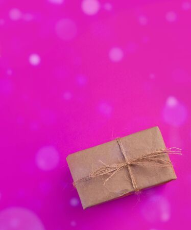 Craft Gift box on a pink background. Space for text.