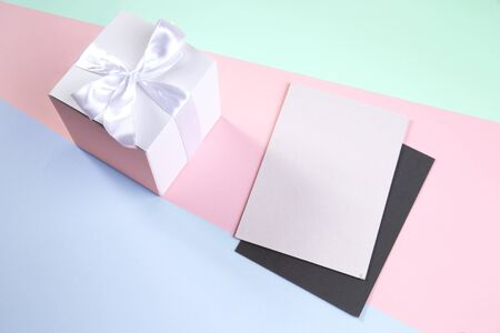 white gift box and greeting card for the holidays. delicate background.