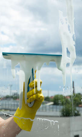 Cleaning in a house or apartment. Removing dirt from windows and windows