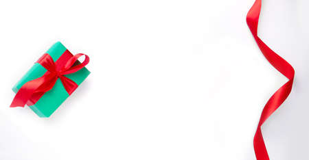 Christmas gift on a white background with red ribbon Stock Photo