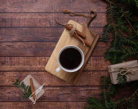 A cup of coffee stands on a dove on a wooden table Reklamní fotografie