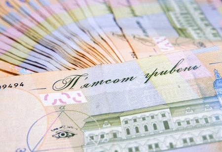 Close-up of Ukrainian hryvna money. many bills of hryvnia. High quality photo