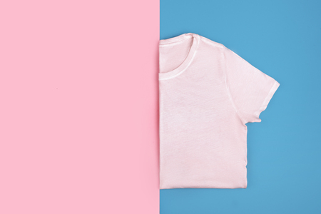 Pink t-shirt isolated on colorful background
