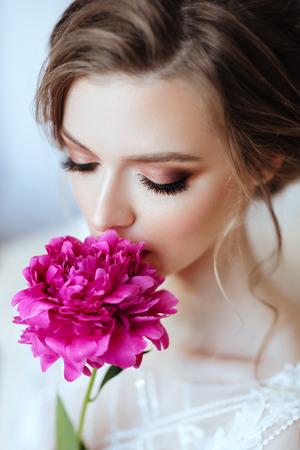 Beautiful model girl with flowers peony