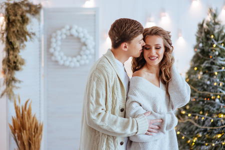 Happy love couple celebrate christmas holidays