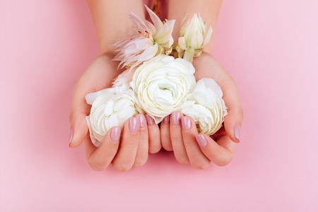 Elegant female hands with Pink Manicured Nails.