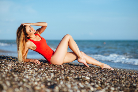 young longhaired girl in red swimsuit Stok Fotoğraf