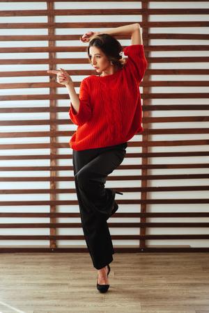 Portrait of young beautiful caucasian woman in red t-shirt Stock fotó
