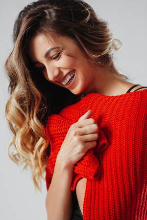 Portrait of young beautiful caucasian woman in red t-shirt cheerfuly smiling looking at camera.