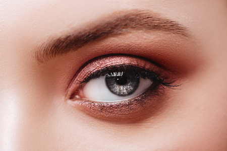 Female Eye with Extreme Long False Eyelashes. Eyelash Extensions. Stock Photo