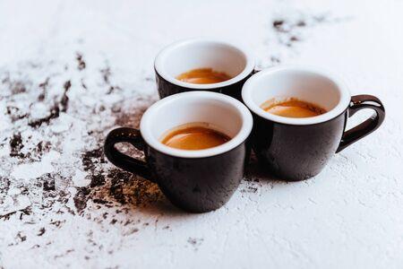Three cups of freshly brewed espresso coffee