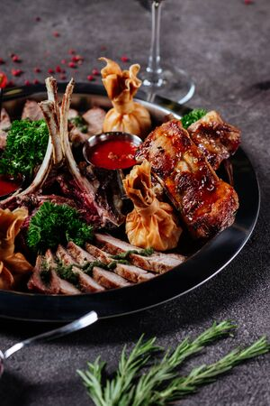 Mixed grilled meat platter. Assorted delicious grilled meat with vegetable.