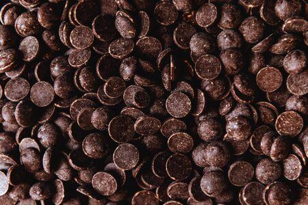 milk chocolate pieces preform candies in daylight for background