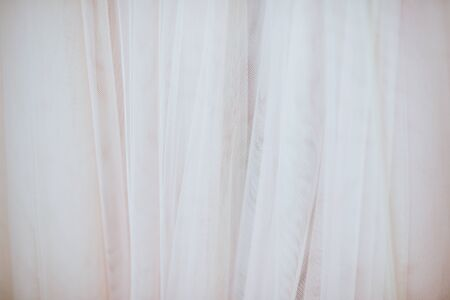 abstract textured background from ivory fabric bridal dress