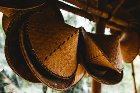 Traditional bamboo hat in a conical shape.